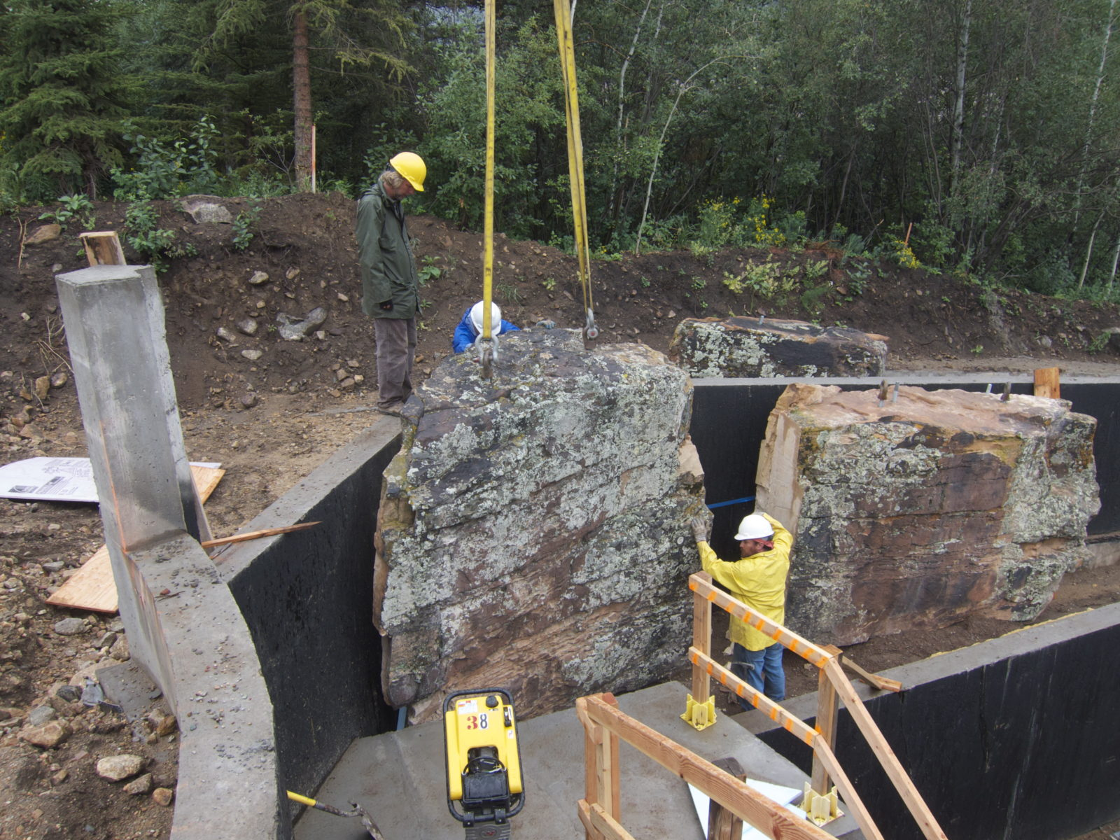 Aspen Custom Landscape Design Project with monumental natural and locally sourced boulder rock feature for Residential Setting, under construction