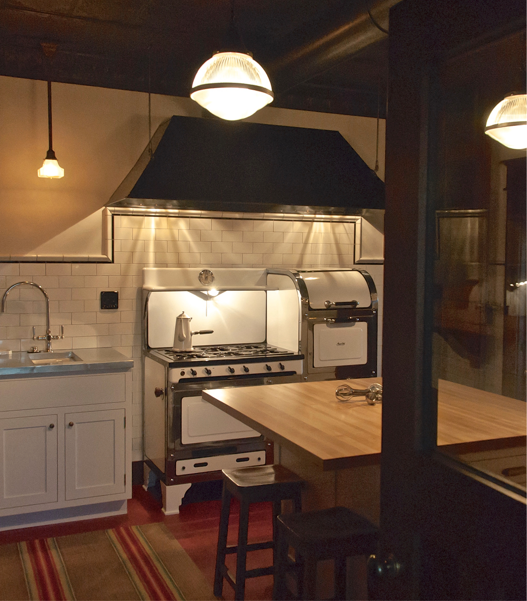 Montana Ranch Architecture and Arts and Crafts Interior Design for Historic Homestead Setting featuring vintage Magic Chef Range with Blacksmith hood and linoleum floor