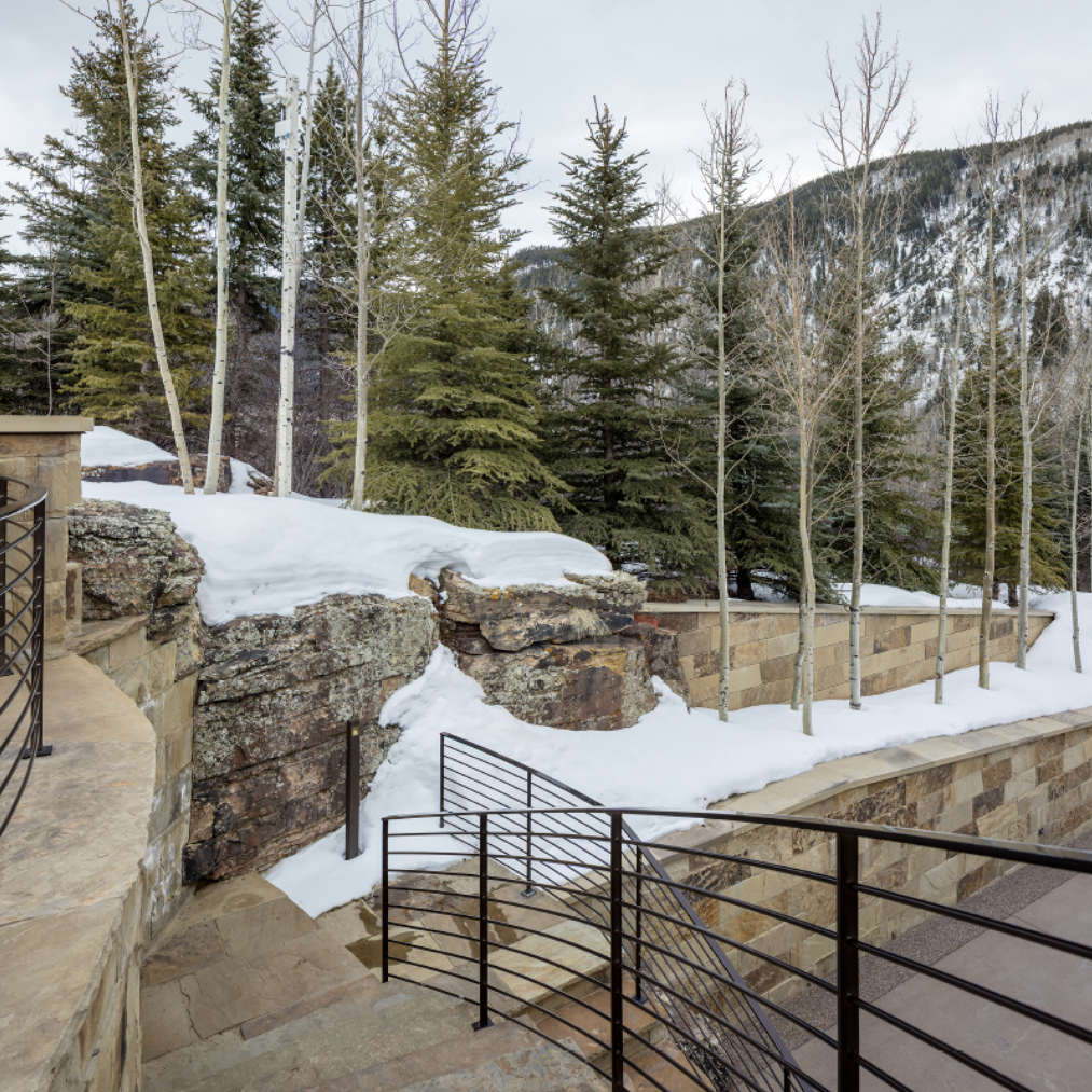 Aspen Custom Landscape Design Project with monumental natural boulder rock and grotto feature for Residential Setting